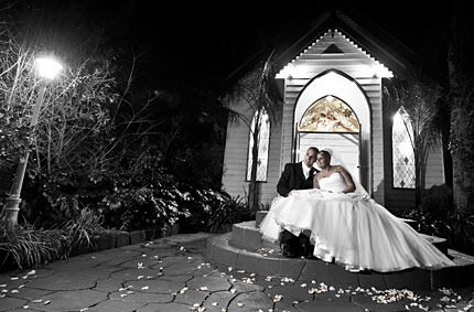 Bride and Groom outside bram leigh chapel, black and white part color.