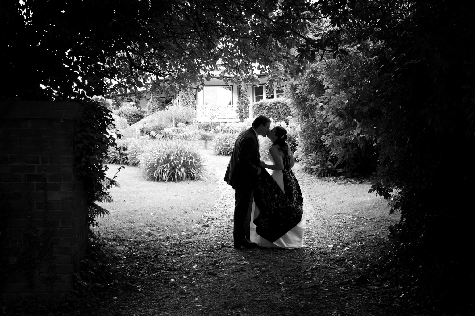 Balck and white wedding photo of a couple in silhouette at forest edge gembrook