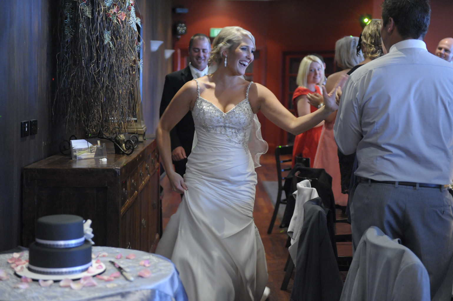 the bride and groom enter their reception at forest edge restaurant gembrook
