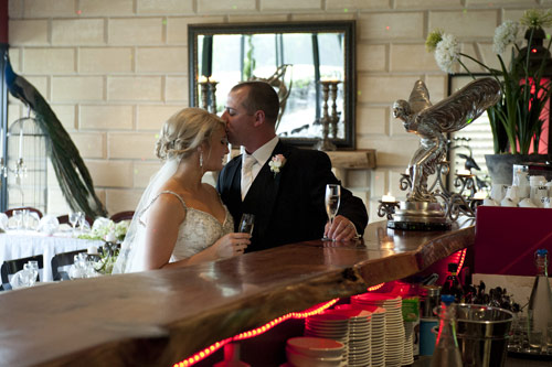 Bride and groom at the bar inside forest edge restaurant gembrook