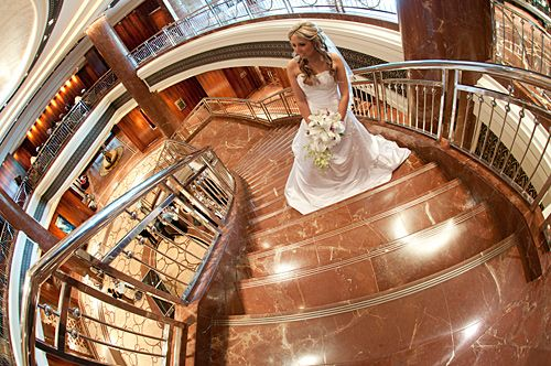 Wedding Photographers Melbourne image of a bride standing on the grand staircase in the foyer of the Park Hyatt Hotel.