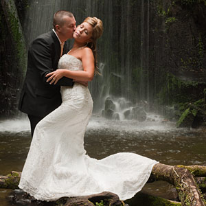 A bridal couple in a waterfall setting in outer Melbourne.