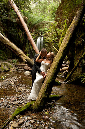 A bridal portrait of a wedding couple in a waterfall setting outside Melbourne.