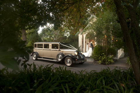 Wedding Photography of 1926 Dodge Limousine gold wedding car.