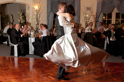 The groom twirls the bride during the bridal waltz