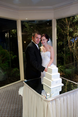 Cutting the wedding cake at Bram Leigh Receptions, Melbourne