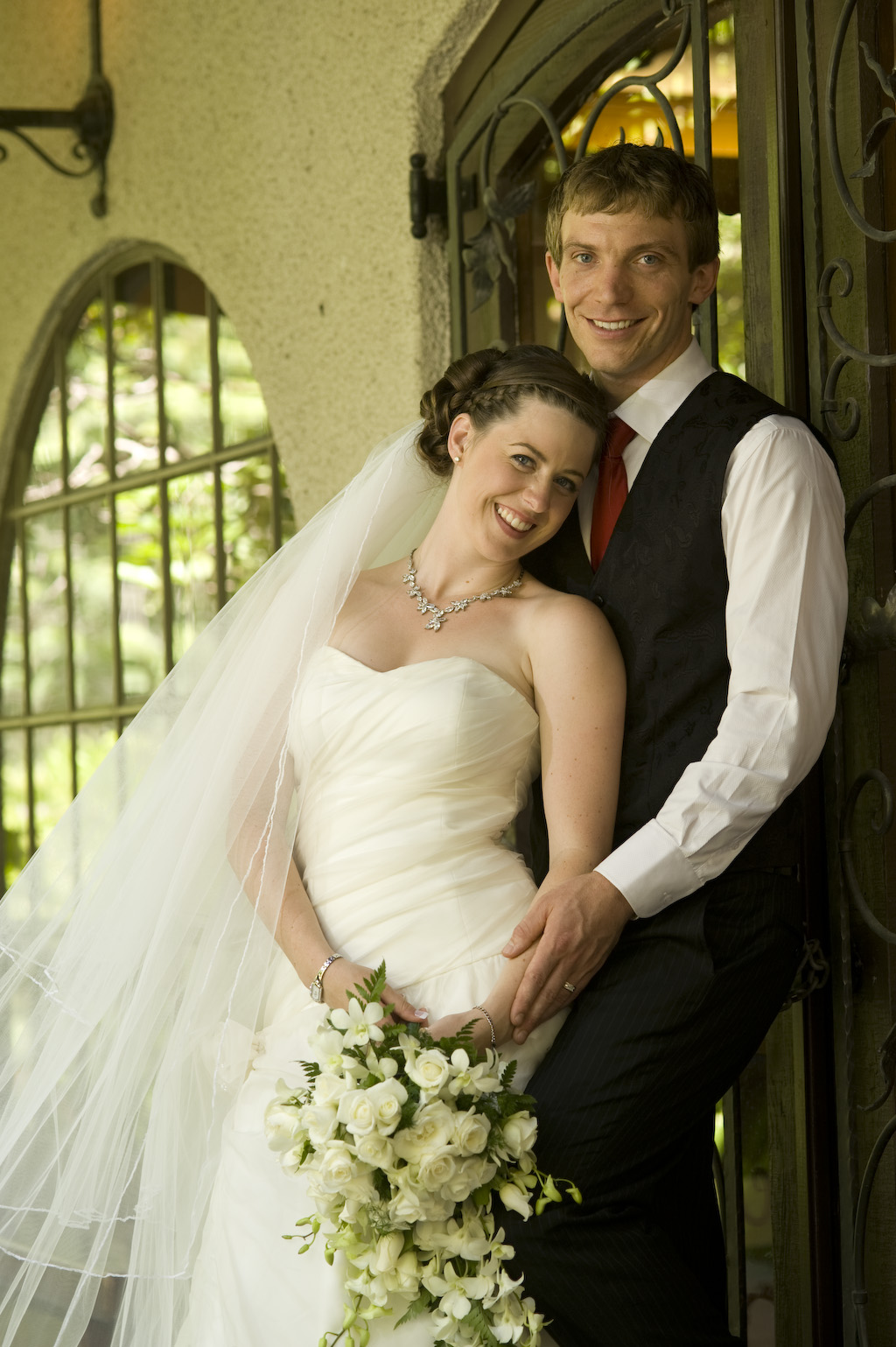 A bridal couple outside the burgundy room at Chateau Wyuna