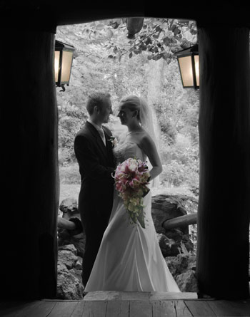 part black and white part color wedding photo chateau wyuna log cabin