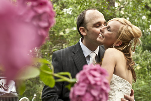 bride and groom kissing in rose garden, chateau wyuna