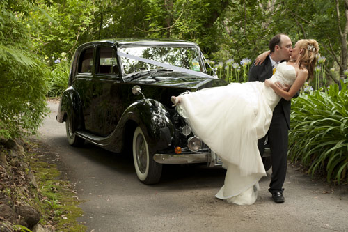 Bride and groom with wedding limousine chateau wyuna
