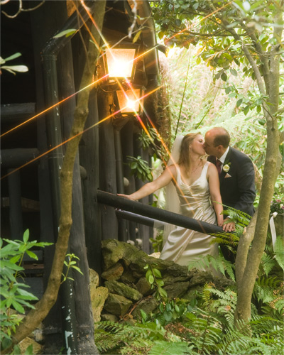 Wedding couple on the steps of chateau wyuna log cabin