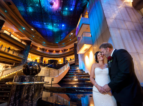 Melbourne weddingphotography at Crown Casino showing foyer and newlyweds