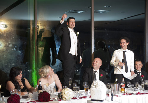 Wedding Photography of Groom toasting during speeches at Skyhigh restaurant.