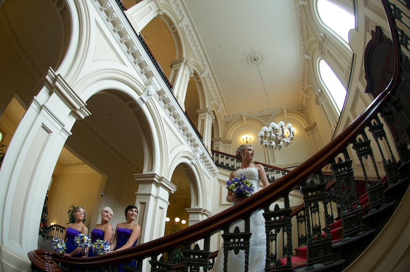 Wedding Photography of bride and maids, hotel stairway.
