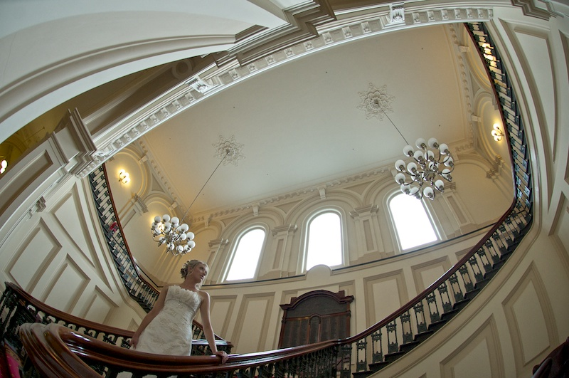 A bride in this melbourne wedding photographer image, featuring a staircase
