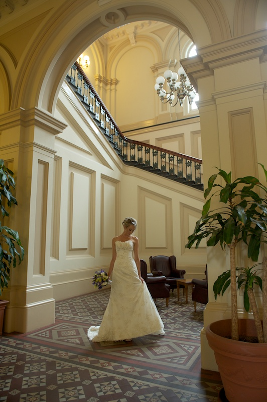 Wedding photography in archway at heritage hotel Melbourne