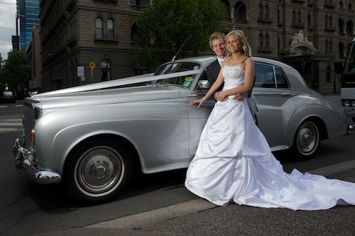 Wedding Photography showing bridal couple and Rolls Royce