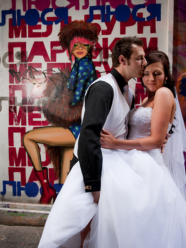 Wedding photography showing bridal couple kissing in Graffiti Lane