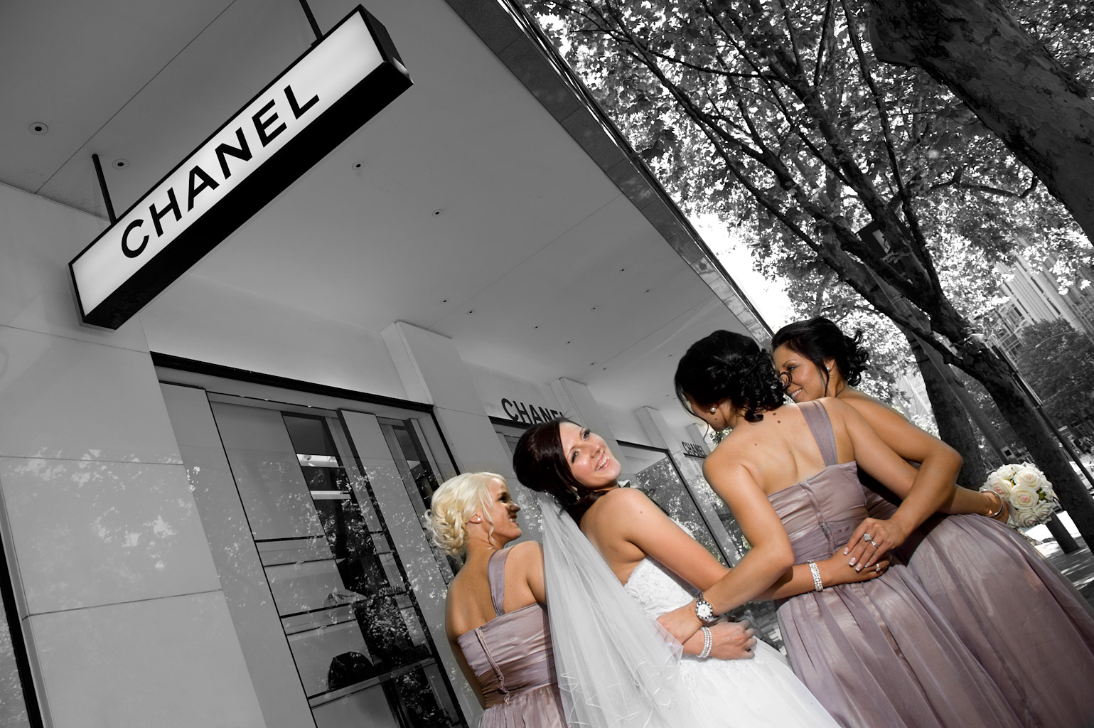 Wedding Photography of bride and bridesmaids outside Chanel in Collins Street
