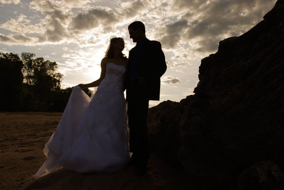 wedding couple silhouetted by outback sunset