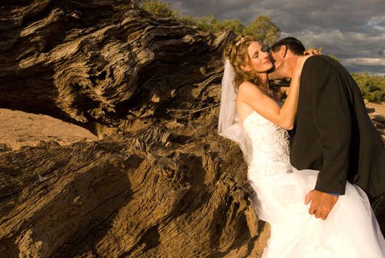Wedding Photography in the bed of the Robinson River with sculpted sandstone cliffs.