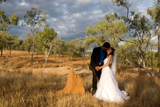 Wedding Photography in Gulf Savannah Grasslands with ant hill and bridal couple