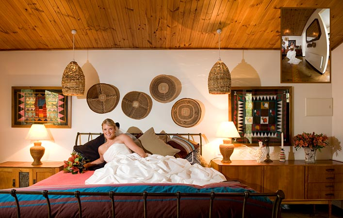 bride on african themed bed before wedding