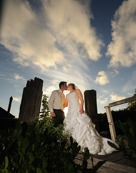 the rustic pier 10 winery makes a dramatic wedding portrait backdrop