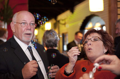 guests blowing wedding bubbles, all smiles venue melbourne