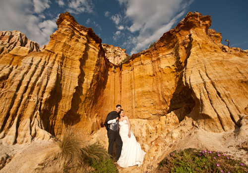 Wedding Photography at Melbourne with a bridal couple and sandstone cliffs.