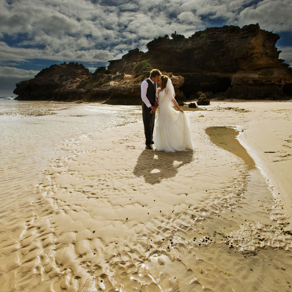 Wedding Photography Melbourne back beach, showing rock pool and newlyweds