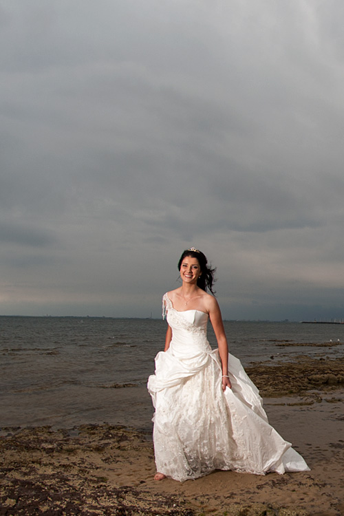 Melbourne wedding phtography showing bride with storm clouds on the beach.