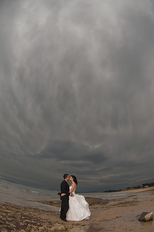Melbourne wedding photographer photo of a storm descending on a beach, with bridal couple