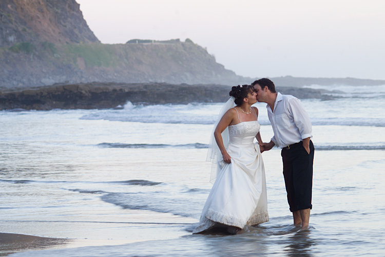 Melbourne wedding phtoographer image of newlyweds kissing in the water at the beach