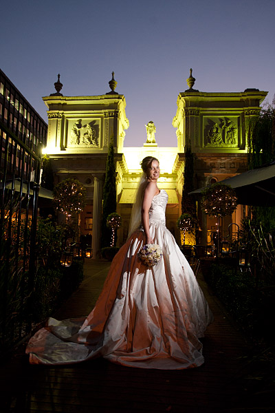 Melbourne Wedding Photographers captured this night shot of a bride by the stunning entrance to the popular Melbourne reception venue The Willows