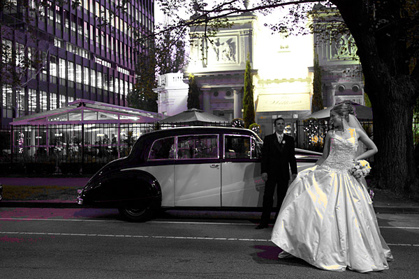 Melbourne Wedding Photographers photo of newly weds and their wedding car from Fleetwood Limousines outside the entrance to the Willows Restaurant, a popular Melbourne Reception venue, in St Kilda Rd South Melbourne.