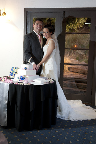 bride and groom cutting cake, potters reception