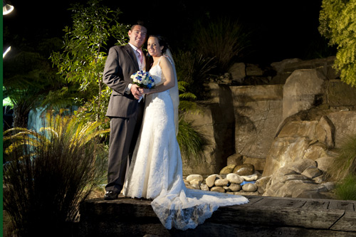 potters reception gardens night wedding photo