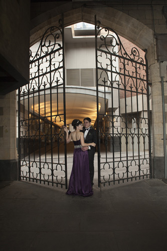 wedding couple pose at registry office chapter house gates