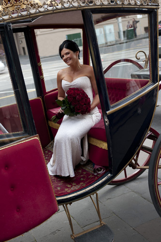 old treasury buillding bride has arrived at horse drawn coach