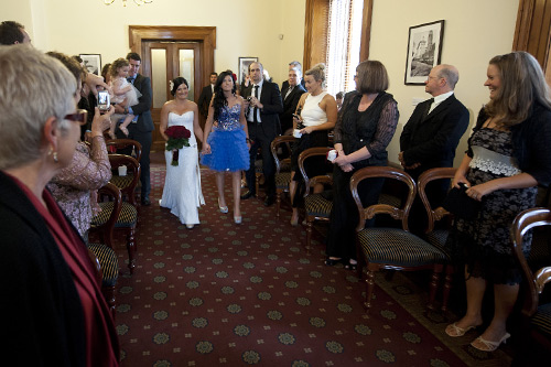 From old Treasury Registry Office wedding walking down the aisle at  Melbourne