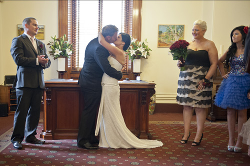 groom kisses bride at  registry office wedding melbourne
