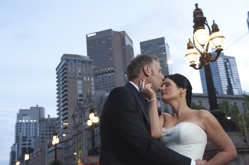 wedding photo of bridal couple kissing on parliament house steps melbourne