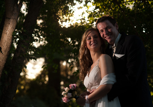 Wedding Photographers Melbourne present dramatically lit portrait which makes a garden look like a forest, taken at Bram-Leigh Croydon