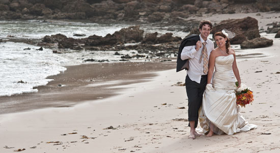 Wedding Photography of a Melbourne Bridal Couple, enjoying a walk along an Ocean Beach foreshore.