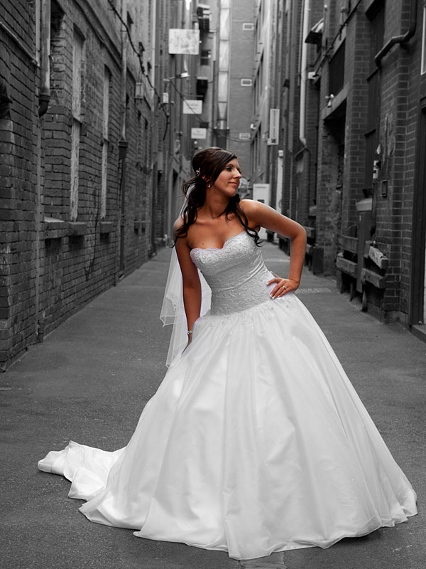 Wedding Photographers Melbourne took this photo of a bride in the central city area, showing off her designer wedding dress.
