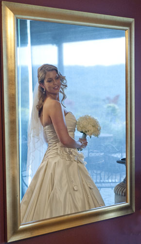mirrored bridal reflection, lit by window light
