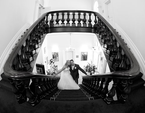 Bridal couple on stairs at Treacy Centre