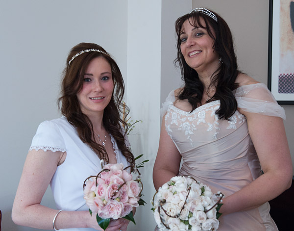 bride and bridesmaid before leavng apartment
